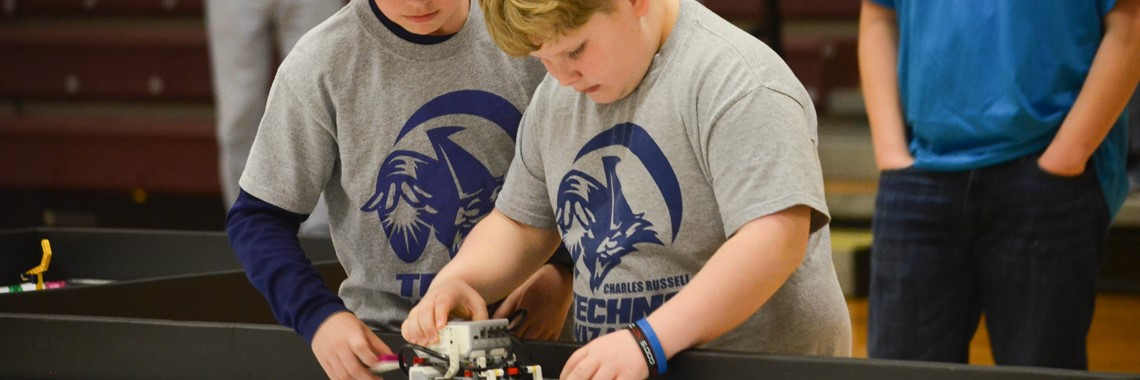 Charles Russell Techno Wizards competing at the regional lego robotics competition.