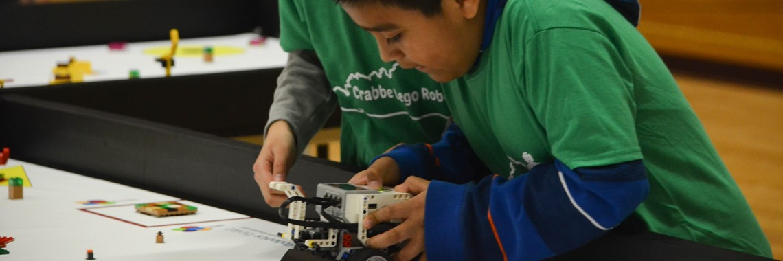 Crabbe Robotics student competing in the regional competition