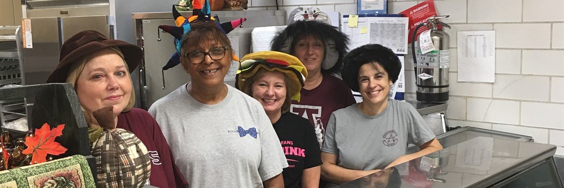 The staff at Crabbe Elementary School celebrate National School Lunch Week with crazy hats.