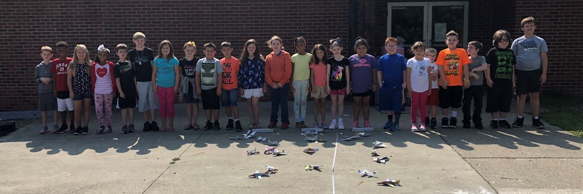 Mrs. Evans class in STEM flying gliders.